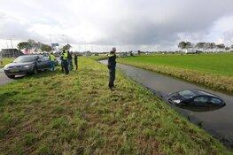 Auto te water gereden in Wognum
